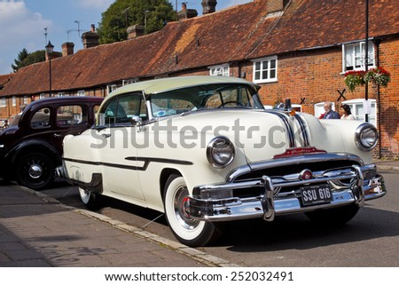 AMERSHAM, UK - SEPTEMBER 7: A vintage and iconic American built Pontiac motorcar stands on public display at the annual Amersham Heritage Day show on September 7, 2014 in Amersham - stock photo