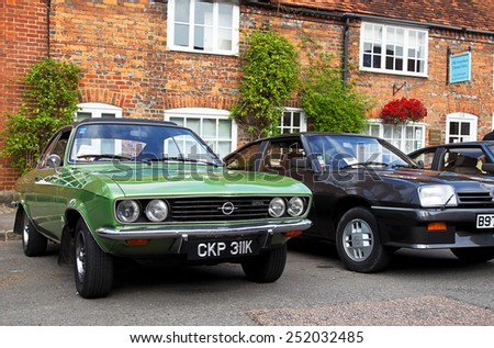 AMERSHAM, UK - SEPTEMBER 7: Two classic Opel Manta sportscars stand on public display at the annual Amersham Heritage Day show on September 7, 2014 in Amersham - stock photo
