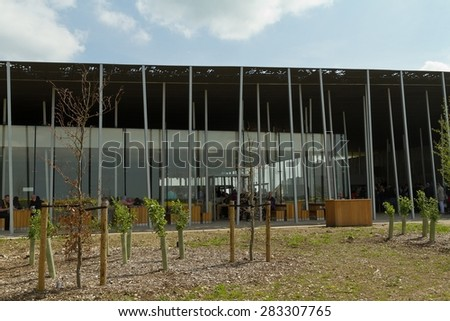 Amesbury, England - circa May 2014: A view taking alongside the metal roof of the Stonehenge Pavilion with vegetation in front taken on a sunny day with limited clouds