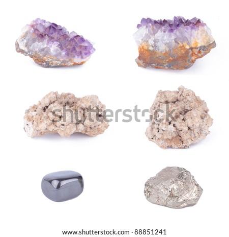 Amethyst, cave rock, onyx, pyrite set on white background - stock photo