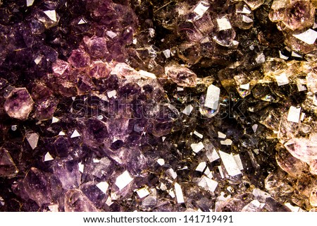 Amethyst crystal background - stock photo