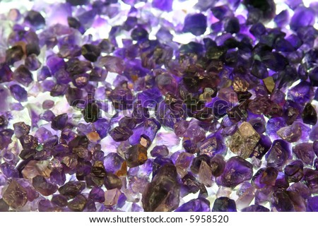 Amethyst crystals rough and uncut raw gemstones - stock photo