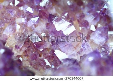 amethyst gemstone mineral as nice natural background - stock photo