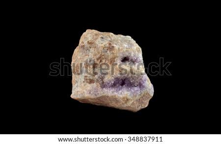 Amethyst in rocks - stock photo
