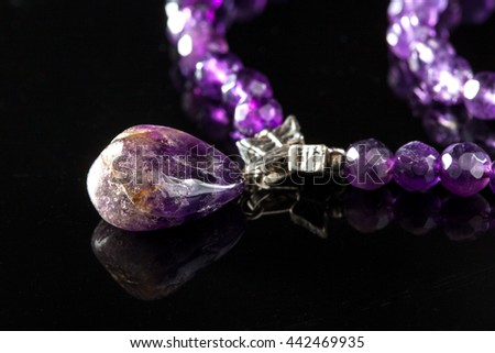 Amethyst pendant isolated on black - stock photo