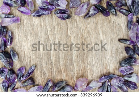 Amethyst Quartz Dog Teeth Rough Purple Crystal on Wooden Table Background for Texture - stock photo