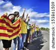 AMETLLA DE MAR, SPAIN - SEPTEMBER 11: Partakers in the Catalan Way on September 11, 2013 in Ametlla, Spain. 1,6 million people took part in the human chain supporting the independence of Catalonia - stock photo