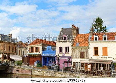 AMIENS, FRANCE - AUGUST 11: Quai Belu at Saint Leu Quarter and Somme river on August 11, 2013 in Amiens, France. This old quarter made of colorful buildings is the most picturesque part of the town.