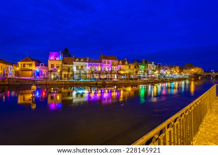 Amiens, Paris, France at night. Beautiful view at the restaurants and cafe at the bench of the river. - stock photo