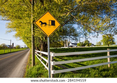 Amish buggy sign along roadway in rural Pennsylvania. - stock photo