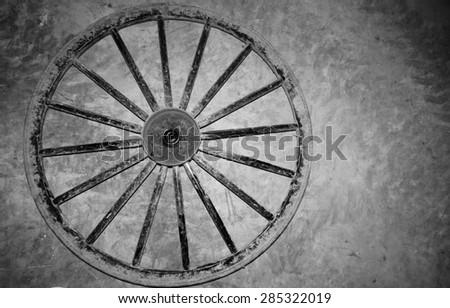 Amish Buggy wheel black and white                                - stock photo