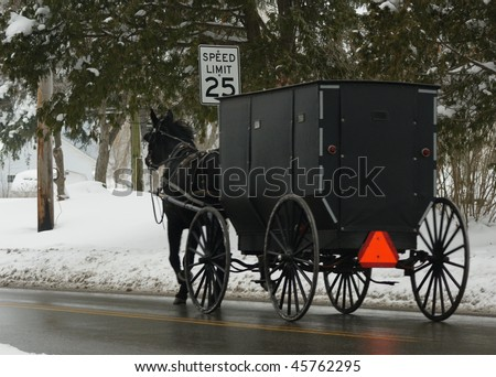 amish horse and buggy in the snow - stock photo