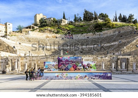Amman, Jordan - April 02, 2015: View of the Roman Theater from Hashemite Plaza. The theater is a famous landmark in Amman, it dates back to the Roman period when the city was known as Philadelphia. - stock photo