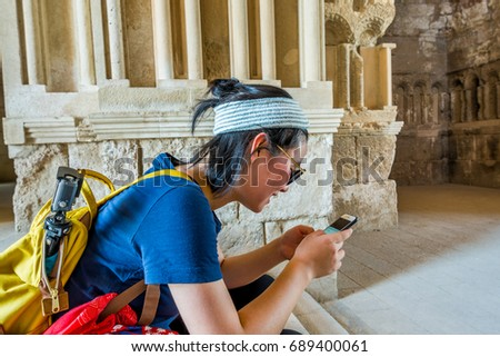 Amman, Jordan, July 17th, 2017, A Chinese tourists sitting inside of the Umayyad Palace of Amman Citadel, a historical site at the center of downtown Amman, Jordan. Known in Arabic as Jabal al-Qal'a
