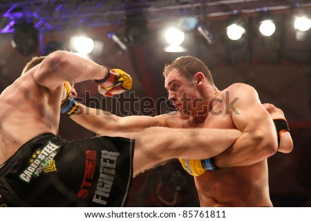 AMMAN, JORDAN - SEPTEMBER 8 : Cathal Pendred (Right) vs Danny Mitchell (left) ends in a Draw, Cage Warriors Championship Fight Night 2, Fight Card on September 8, 2011 in Amman, Jordan - stock photo