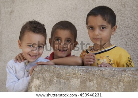 Amman, Jordan-September 19, 2009: Young Iraq refugees stand outside their home  in a camp outside of Amman, Jordan