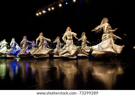 AMMAN - MARCH 15: Female dancers from Chechnya Wainakh ensemble performing for Jordanian Audience and royal family, during Kadyrov's visit to Jordan. March 15, 2011 in Amman, Jordan.