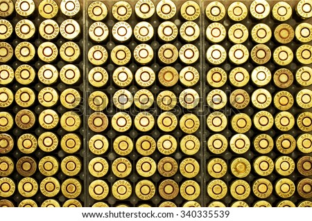 ammo to machine guns and pistols in the cage - stock photo