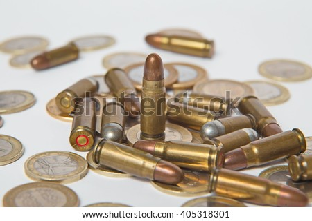 Ammunition and valid coins. Sales of weapons and ammunition. Illegal trade of ammunition - stock photo