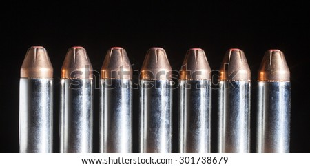 Ammunition for a thirty eight caliber handgun with bullets that have a polymer tip on black - stock photo