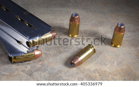 Ammunition with hollow point bullets and magazines for a handgun - stock photo
