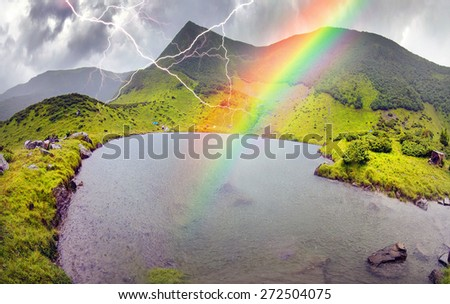 Among the popular tourist destinations of Ukraine tour of the mountain lakes of Montenegro and Svydovets ridge. Clean water, high tops, a sudden storm and rain and thunderstorms - stock photo