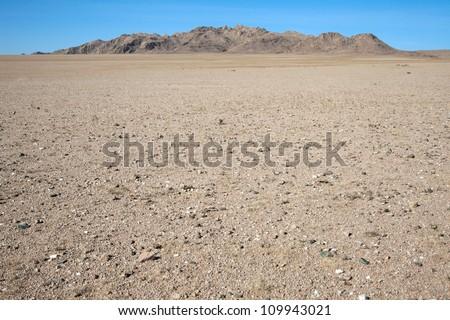 Among the rocky hill of dunes in the Gobi Desert - stock photo