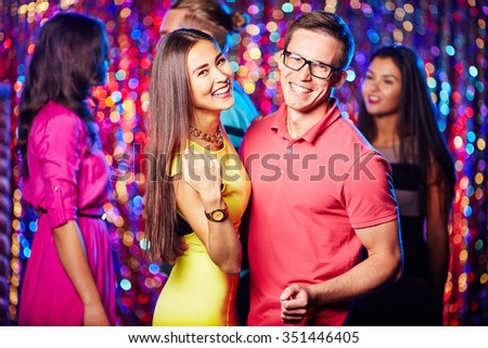 Amorous couple dancing in night club at party - stock photo