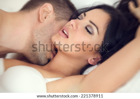 amorous couple making love in bed - stock photo