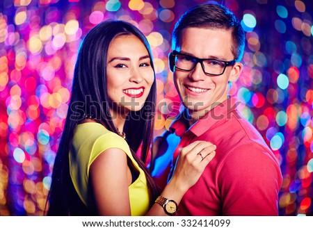 Amorous dates enjoying night party in club - stock photo