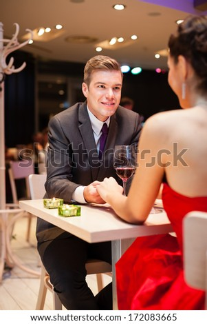 Amorous men with his girlfriend at the restaurant  - stock photo