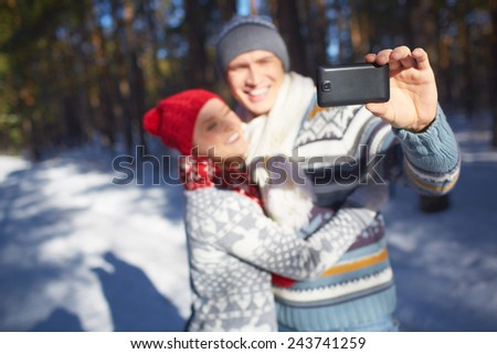 Amorous young couple making their selfie in natural environment - stock photo
