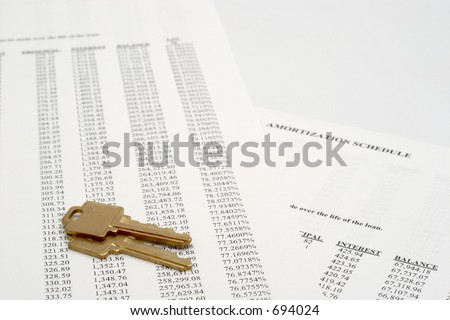 Amortization schedule with a pair of house keys - stock photo