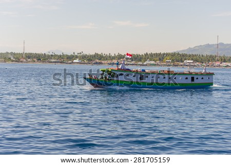 Ampana, Indonesia - August 23, 2014: Crowd traveling on an obsolete ship heading to the Togean (or Togian) Islands, Central Sulawesi, Indonesia. Concept of travel safety in developing countries.