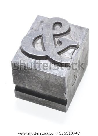 ampersand metallic letterpress type block isolated on white - stock photo