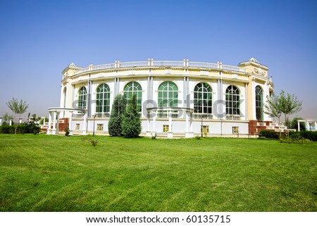 Amphitheater building in green meadow - stock photo