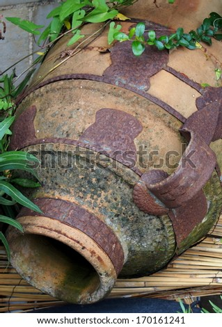 Amphora with iron cast reinforcements - stock photo