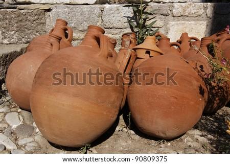 Amphorae in the garden - stock photo