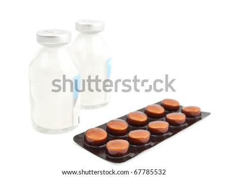 ampoules and pills on a white background - stock photo