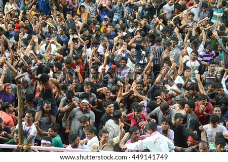 "AMRAVATI, MAHARASHTRA, INDIA - AUGUST 29 : Crowd of young People enjoying ""Govinda"" at Dahi Handi festival to celebrate God Krishna's Birth in Amravati, Maharashtra, India. 29 August 2013"