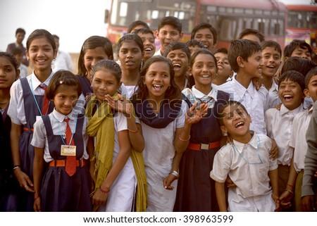 AMRAVATI, MAHARASHTRA, INDIA -  FEBRUARY 5 : Happy Indian rural school boy and girl at their school,  Amravati , Maharashtra, India 5 February 2016. - stock photo