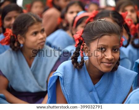 AMRAVATI, MAHARASHTRA, INDIA -  FEBRUARY 5 : Happy Indian rural school girl at their school,  Amravati , Maharashtra, India 5 February 2016. - stock photo