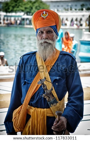 AMRITSAR, INDIA-AUGUST 10: unidentified armed Nihang in the Golden temple of Amritsar, India on august 10, 2008. Nihang are an armed Sikh order known to be brave warriors
