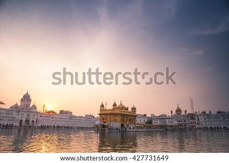 AMRITSAR, INDIA - NOVEMBER 28, 2013: Golden Temple, the main temple and holiest Gurdwara of Sikhism religion,  Sri Harmandir Sahib Gurdwara in  Punjab, India.  - stock photo