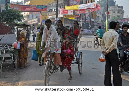 AMRITSAR, INDIA - OCTOBER 29: Group of people travel by rickshaw in Amritsar on October 29, 2009. Unsatisfactory public transportation limits Indian people in everyday traveling.