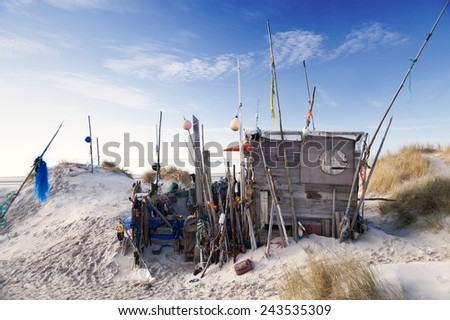 AMRUM, GERMANY - DECEMBER 29, 2014: On the Kniepsand Beach of  the North Frisian Island Amrum in Germany Land-Artists made Beach Huts and other Objects out of Flotsam and Jetsam - stock photo
