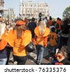 AMSTERDAM - APR 30: City natives and tourists celebrate Queen's Day, Dutch annual national holiday, in the streets of the city, April 30, 2011, Amsterdam, The Netherlands - stock photo