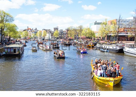 AMSTERDAM - APR 27: People celebrating Kings Day in Amsterdam on April 27. 2015 in the Netherlands - stock photo