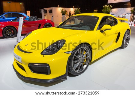 AMSTERDAM - APRIL 16, 2015: New 2016 Porsche Cayman GT4 sports car at the AutoRAI 2015. - stock photo