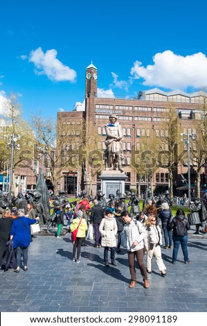Amsterdam-April 30: Rembrandtplein with Rembrandt monument and representation The Night Watch, by Mikhail Dronov and Alexander Taratynov on April 30, 2015, the Netherlands. - stock photo